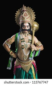 Portrait of a person dressed-up as Ravana the Hindu mythological character and holding a mace