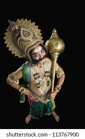 Portrait of a person dressed-up as Ravana and holding a mace