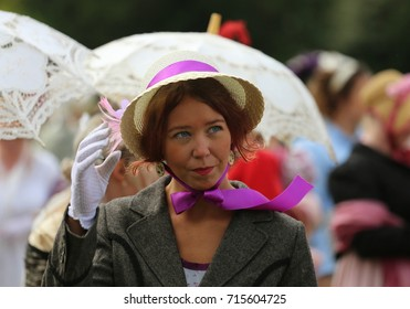 Portrait photo of an English woman in bonnet hat at the Regency Costumed Promenade,the 200th anniversary of Jane Austen's death in Bath,Royal Crescent,England,United Kingdom.09/09/2017
