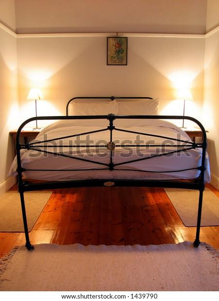 Portrait photo of farm house bed.