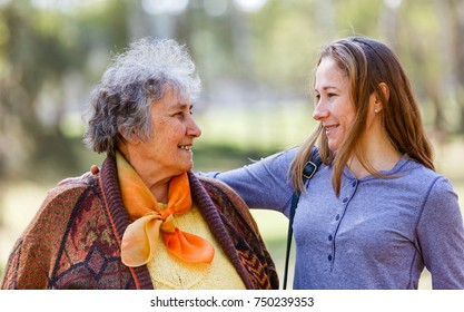 Portrait photo of happy elderly woman with her daughter