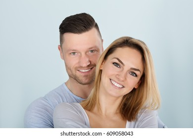 Portrait Photo Of An Smiling Young Couple