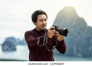 Portrait of photographer or the tourist over the Fantastic Landscape of samed nang chee view point at the sunrise time, Travel and holiday concept