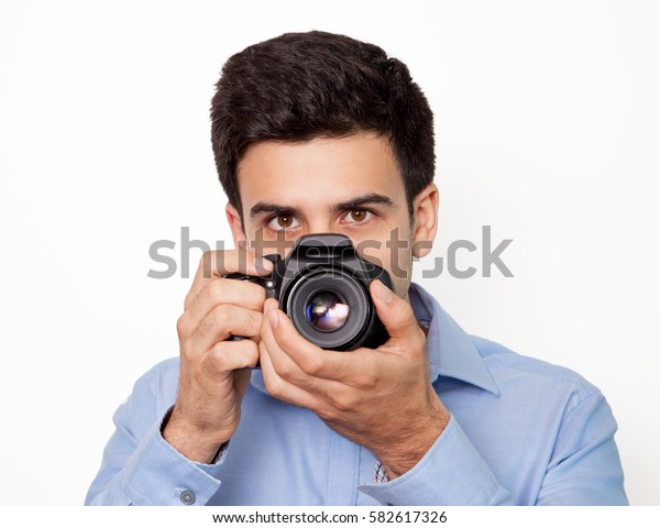 Portrait of photographer at work