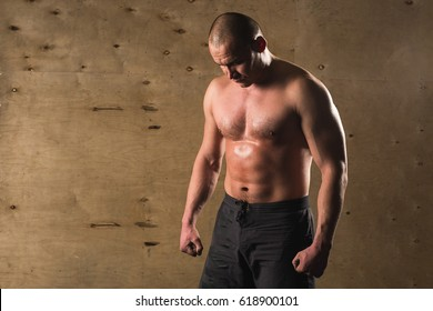 Portrait Of A Physically Fit Man Resting In A Health Club