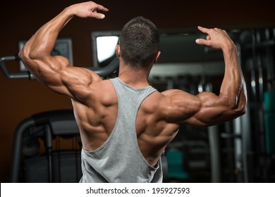 Portrait Of A Physically Fit Young Man - Flexing Muscles - No Pain No Gain