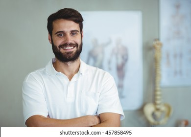 Portrait of physiotherapist standing with arms crossed in clinic