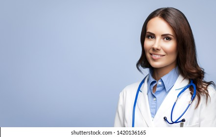 Portrait picture of happy smiling female young doctor in white uniform coat and stethoscope, isolated over grey background. Healthcare, medical, medicine specialist - concept. Copyspace.