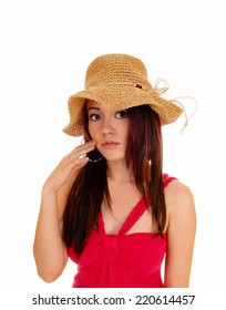 A portrait picture of a pretty young  Asian woman in a red dress wearing a  beige straw hat, isolated for white background.