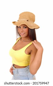 A portrait picture of a young woman wearing a yellow t-shirt an a straw hat, standing isolated for white background.