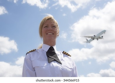 Portrait of a pilot with a passenger jet in the sky
