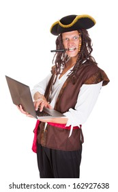 Portrait Of A Pirate Using Laptop Holding Knife In His Mouth