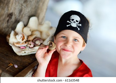 Portrait of playful boy dressed as pirate