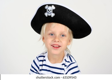 Portrait of playful cute boy dressed as pirate