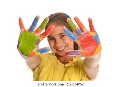 Portrait of playful young girl with paint on hands isolated over white background
