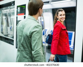 Portrait of playful young people making acquaintance in public transport