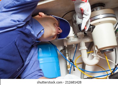 Portrait of a plumber at work