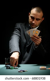 Portrait of a poker player over black background