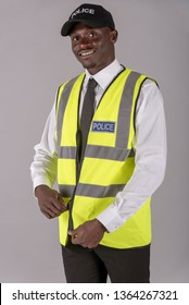 Portrait of a police officer zipping up his uniform jacket