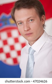 portrait of politician in front of a croatian flag
