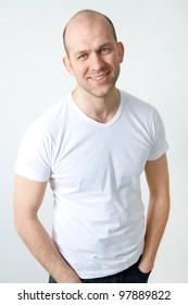 Portrait of positive bald-headed smiling man