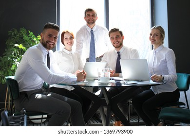 Portrait of a positive business employees at an office business meeting.
