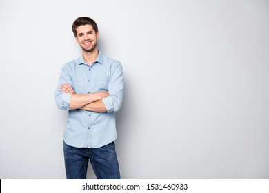 Portrait of positive cheerful cool college university man cross hand feel like true leader person wear denim jeans style outfit isolated over grey color background