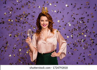 Portrait positive cheerful girl bachelorette hold champagne glass enjoy graduation party have gold tiara wear good look skirt isolated violet bright shine color background with serpentine blow