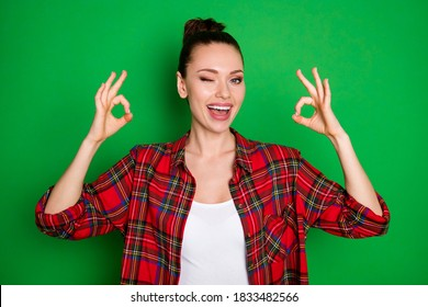 Portrait of positive cheerful girl promoter suggest select perfect adverts promotion show okay sign wink blink wear good look clothes isolated bright shine color background