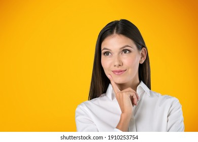 Portrait of positive cheerful girl thoughts and looking to the side