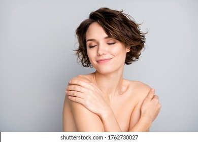 Portrait of positive cheerful pretty girl touch her body have shower enjoy new rejuvenation soft perfect ideal balm cream isolated over gray color background