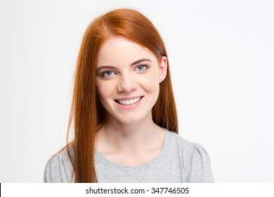 Portrait of positive cheerful young female with long red hair looking at camera isolated over white background