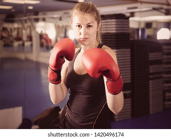 Portrait of  positive french  woman who is training in box gym.