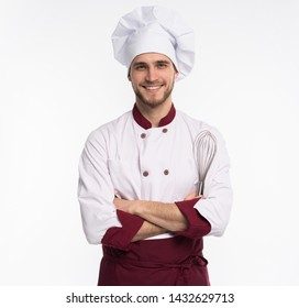 Portrait of positive handsome chef cook in beret and white outfit isolated on white background