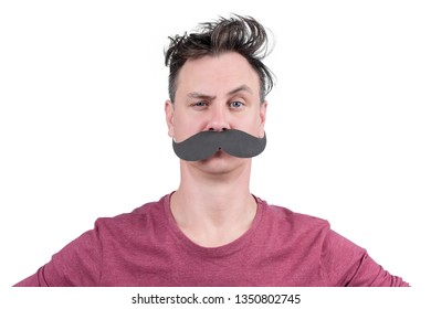 Portrait of a positive man with cardboard mustache and arched eyebrow, isolated on white background