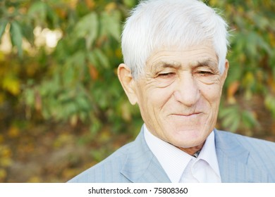 Portrait of positive senior man in formal wear