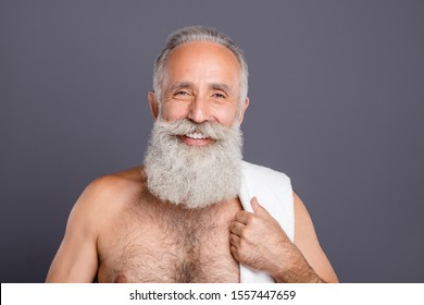 Portrait of positive well good old man with towel hanging on his shoulder having just exited bathroom naked isolated over grey color background