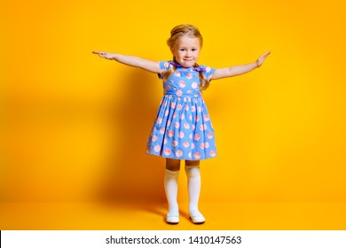 A portrait of a positive young pretty girl. Summer bright fashion for kids.