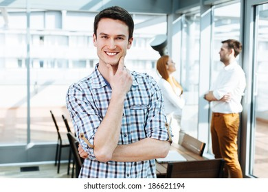 Portrait of a positive young professional looking at camera