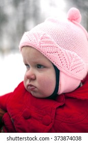 Portrait of pouting baby girl made in winter day.