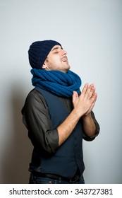 Portrait of praying businessman looking upwards in isolation