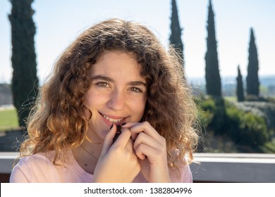 Portrait of a pre-adolescent girl posing in a public park on a sunny spring day