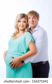 portrait of a pregnant woman with her ??husband