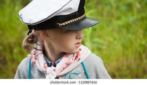Portrait of a preschooler girl looking attentively at something outdoors