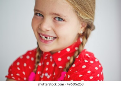 Portrait of preschooler girl with open mouth without milk tooth