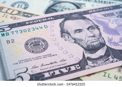 Portrait of  president Abraham Lincoln and Federal Reserve System (FED) seal macro detail on a five dollar banknote or bill. Concept of central bank and USA or global world economic financial.