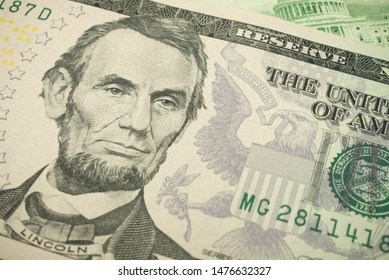Portrait of  president Abraham Lincoln and Federal Reserve System (FED) seal macro detail on a hundred dollar banknote or bill. Concept of central bank and USA or world economic financial, trade war.