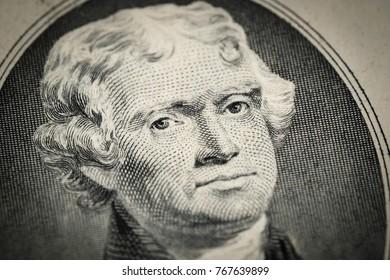 Portrait of President Thomas Jefferson portrait on two (2) american dollar bill. Macro close up view.