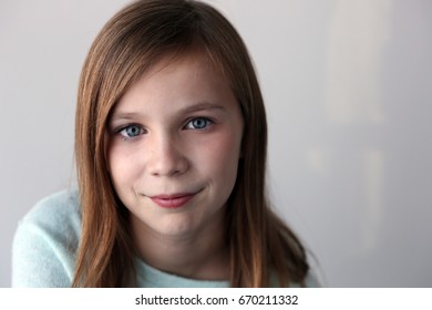 portrait of preteen with blue eyes