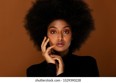 Portrait of pretty afro american woman in a studio for a beauty session - Beautiful girl posing on colored background - Shutterstock ID 1529390228